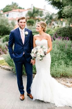 A beautiful destination wedding for Danielle and Bobby. A french blue suit and pink tie with a gorgeous bride by his side!