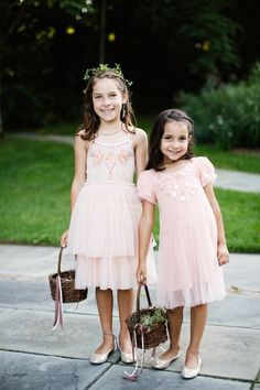 Blush fall flower girl dress idea - blush knee-length dresses with greenery floral crown + baskets of flower petals tied with ribbons {Betsi Ewing Studio}