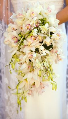 white cymbibiums with white dendrobiums in a cascading style bouquet.