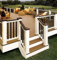 love the white posts and wood deck. I will have this kind if deck one day!!!!