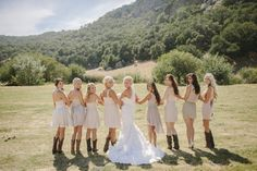 mismatched palest of pink and neutral colored bridesmaids dresses, cowboy boots, bridesmaids in cowgirl boots, rustic glam ranch wedding