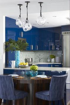 """I never tire of Cerulean blue. It is timeless and pairs beautifully with so many other colors. I especially like using it on unexpected surfaces, like the kitchen cabinets above, which are done in Benjamin Moore's Marine Blue (2059-10). When used in a high gloss lacquer, the intensity of the color is really highlighted."""