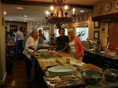Andrea with students prepping food in the kitchen at the Healdsburg, CA cooking school.