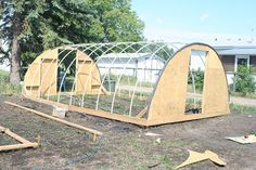Blog author's third hoop style greenhouse by albertahomegardening, via Flickr