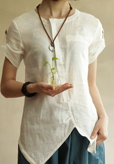 Linen blouse with asymmetric closure