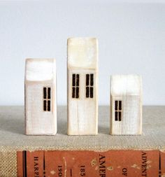 miniature wooden houses, like the lime washed effect