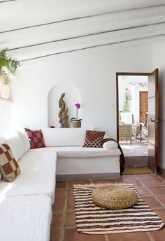 Change walls to Tuscan yellow and add tons of colorful pillows to the bench. Turn bench to face courtyard with pool.