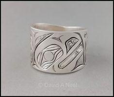 A wide Raven Ring in silver, by David Neel, Kwakiutl #northwestCoastIndianArt #firstNationsArt #nativeArt #nativeAmericanArt #canadianAboriginalArt