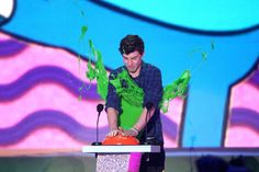 Pin for Later: See Stars Get Slimed at the Kids' Choice Awards! Shawn Mendes The singer/songwriter got hit at the podium.