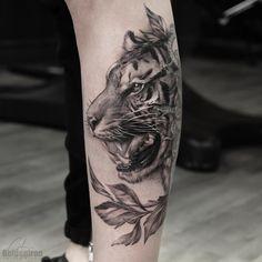black and grey tiger tattoo design on leg @grxsy