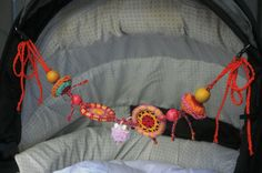 Colourful crocheted baby pram or cot rattle by SOPSforKids on Etsy