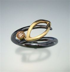 Danielle Miller/ reminds me of my wedding ring design a bit :)