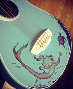 Luna guitar, holy mother taledo i want one of these so bad! :O Not to mention my obsession with mermaids!! :))