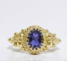 Vintage Tanzanite Ring https://www.etsy.com/listing/249513124/ladys-vintage-tanzanite-14k-yellow-gold