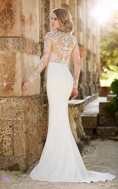 Handcut Guipure Lace is individually placed on the illusion tulle bodice of this sexy, sheath, ivory bridal gown from the Martina Liana collection.