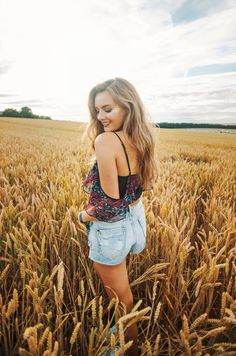 Lifestyle blogger @niomismart  captured in the fields of gold at Farr Festival in Hertfordshire wearing the new Matthew Williamson off-the-shoulder painted python top. #ohMW #festivalfashion