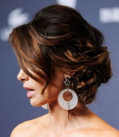 The coolest thing about Kate Beckinsale's hairstyle here isn't the actual updo, it's the color. If you want to play up your highlights, try a complex style full of movement.  - GoodHousekeeping.com