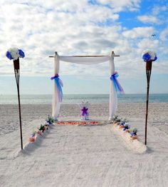 Blue and purple is the theme for a two post arch wedding on a perfect day in Florida