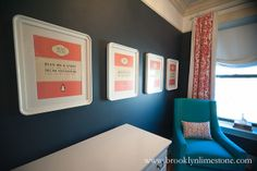 Beautiful nursery with dark navy blue walls framing art over vintage changing table next to turquoise glider, Jennifer Delonge Glider, situated in front of window in white and orange suzani curtains. Book Themed Nursery, Nursery Themes, Nursery Art, Nursery Design, Nursery Inspiration, Color Inspiration, Interior Inspiration, Navy Paint Colors, Contemporary Windows