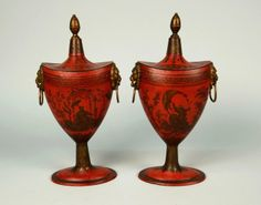 PAIR FRENCH RED GROUND TOLE PEINTE CHINOISSERIE DECORATED CHESTNUT URNS, 19th century; with lion mask handles; height: 13 1/2 inches
