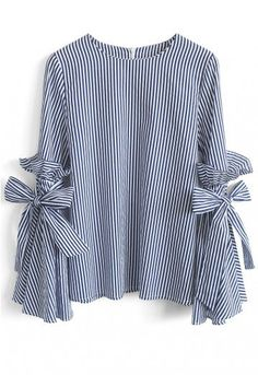 Gotta earn your stripes, babe, and there's no better way to own them than this dramatic Charisma top with bell sleeves, ruffles and self-tie bows. - Bell Sleeves with Self-tie bowknot and ruffles - Spilt cuffs - Concealed back zip closure - Not lined - 100% Polyester - Hand wash Size(cm)Length Bust Shoulder Sleeves XS/S 61 90 37 58 M/L 62 94 39 59 XL 63 98 41 60 S...