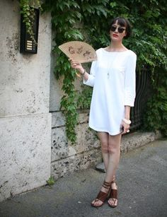 Loving these simple white dresses! Via June 1 : 30 Perfect June Outfits : Lucky Magazine