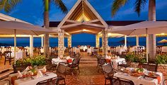 Enjoy fine dining with gorgeous ocean views at Chef's Pietro at Grand Pineapple Antigua Resort