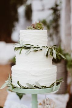 Wedding Cake | Olive branch decor | Photography: Les Amis Photo | See more on #SMP Weddings: http://www.stylemepretty.com/destination-weddings/2013/12/19/masseria-mozzone-inspiration-shoot/#comment-703151