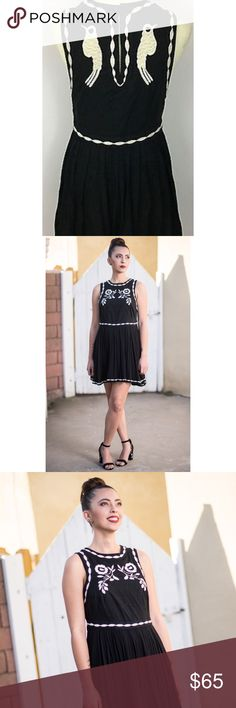 "Birds of A Feather Black Embroidered Mini Dress Free People Birds Of A Feather Black Embroidered Mini Dress  Measurements• under arm to under arm across: 16""• waist across: 16""• length: 32""• In a sleeveless silhouette this ethereal mini dress features beautiful embroidery with a full skirt and pleat detailing. Keyhole opening in back with a button closure. Hidden side zip. Free People Dresses Mini"