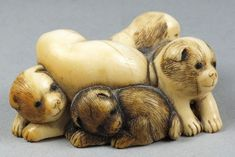 A 19th century ivory netsuke: carved as a group of