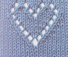 knitted heart pattern with symbols (explanation of symbols found in comments section)