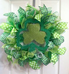 Happy St. Patricks Day! This wreath measures approximately 24 In diameter. It features curly deoc mesh, polka dot and shamrock ribbon, along