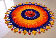 Creative rangoli designs Perfect For Sprucing Diwali Rangoli designs 2019 are about incorporating flowers in them. Flower wedding rangolis have gained much popularity this wedding season. Rangoli Designs Simple Diwali, Indian Rangoli Designs, Rangoli Designs Latest, Rangoli Designs Flower, Rangoli Border Designs, Small Rangoli Design, Rangoli Patterns, Rangoli Ideas, Rangoli Designs With Dots