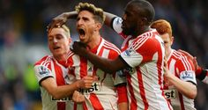 Liverpool are everywhere. Fabio Borini celebrates with his Sunderland team-mates, his winning penalty against Chelsea at Stamford Bridge. Liverpool are everywhere! Photograph:  Mike Hewitt/Getty Images