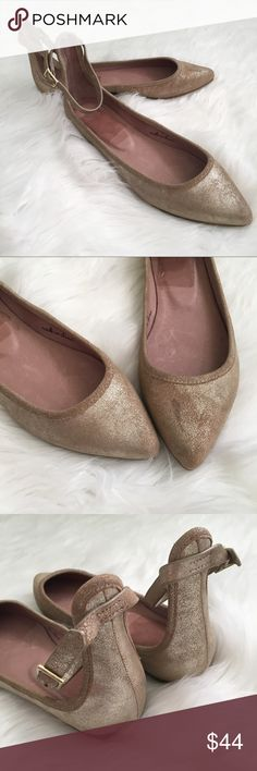 Joie Temple Metallic Ankle Strap Pointed Toe Flats Joie Temple Metallic Ankle Strap Pointed Toe Flats.  They are a rose gold color. Never worn. There is a scuff on the front of one toe. Pictured in the last photo. The store put the price tag on the inside of the shoe which is what the marks are from. Otherwise in good condition.   ⭐️10% off 2+ bundle  ⭐️Size 39 Joie Shoes Flats & Loafers