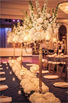 Tall Candleabra with White Flower Arrangement ~ Elegant Wedding Decor ~ Photo: Ama Photography & Cinema
