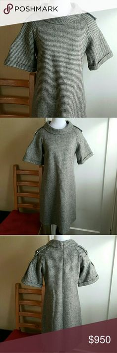 "Burberry London dress Tweed dress Brand new, never worn. Size 40 or medium 70% wool. 20% viscose. 10% cotton. 100% polyester lining.  Zip back 17"" bust and waist. 13"" sleeves. 19.5"" hips. 37"" long. Burberry Dresses"