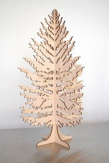 plywood christmas tree. comes also in white. and you could always paint it, say, green, for example.