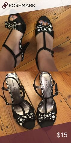 Size 7 American Eagle black and white heels These pretty heels are American eagle brand. They've been worn only a few times in my high school years to school dances where we took our shoes off our achey feet 25 minutes into the dance. They're all black with some white polka dots. They've got a bow on the front, they're open toed and they have a strap around the back for support. American Eagle Outfitters Shoes Heels