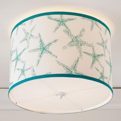 Starfish Drum Shade Ceiling Light This trendy starfish pattern is always a must when adding a little bit of the beach to your home! Comes in Aqua and Navy. 100% Polyester and made in America. Shade: (16x16x10.5) 2 x 40W max medium base sockets.