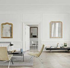 Friz Hansen chairs. Antique gold mirrors.