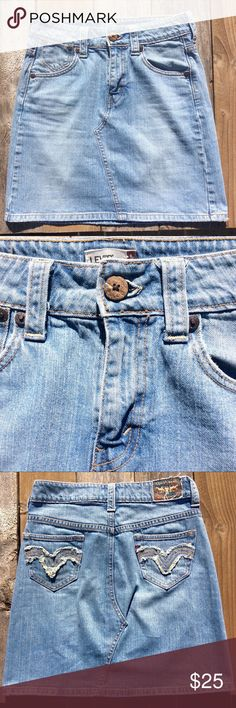 """Re Done Inspired Levi High Waisted Skirt Stunning one of a kind vintage high waisted Jean skirt. Wood Button with frayed colored jean detailing on pockets. Embellished Levi tag. Length:18.5"""" Waist:15"""" RE/DONE Skirts"""