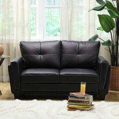 This black love seat provides a contemporary accent to any room.