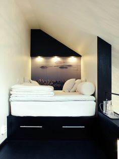 """designed-for-life: """"Check out this small studio apartment design. It belongs to Swedish interior designer Jimmy Schonning. His diminutive studio is chockablock with creative storage solutions (built-in closets; a washer and drier hidden under a. Small Apartment Bedrooms, Attic Apartment, Attic Rooms, Small Apartments, Stockholm Apartment, Attic Loft, Attic Bathroom, Apartment Therapy, Attic Library"""