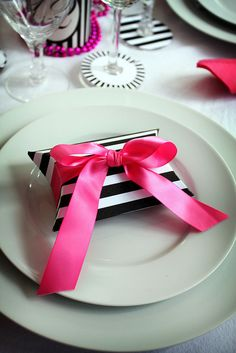 Black and white striped paper box with bright pink bow - gold and pink themed wedding