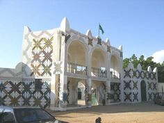Kano Emir's Palace l North Nigeria, Africa l Constructed some time in the 19th century. The palace adopts the recurring theme of structures and edges corners with pointed-tips atop the roof, along with the semi-curved windows and pillars. the building is given a coat of white interrupted by highly decorative themes everywhere.