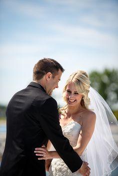 Lakeside waterfront bride groom first look.