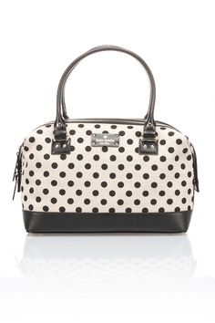 Belletown Justina Bag in Natural and Black Spot Known for her playful use of crisp colors and graphic prints, Kate spade New York strives to give exuberance to the everyday; What began with Kate spade handbags in 1993 has grown into a lifestyle brand with global name recognition; This handbag features zipper into main compartment; Double rolled handles; Inner zipper and drop pockets; Protective metal feet Women