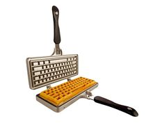 CTRL + ALT + DELicious! The Keyboard Waffle Iron (KWI) is a unique kitchen gadget that creates delicious Belgian-style gourmet waffles in the shape of your beloved computer keyboard. Its 'wireless' design works on the kitchen stove, backyard BBQ, or outdoor grill.
