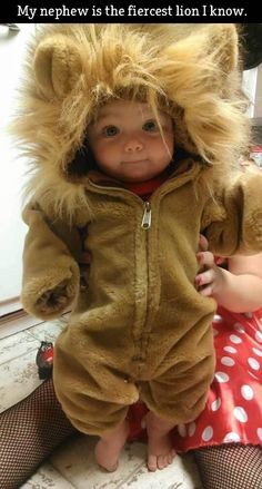 Whoever's nephew this is, the little cutie sure is one fierce lion!! Awwww!